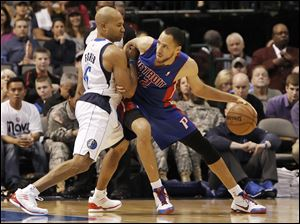 Detroit Pistons forward Tayshaun Prince (22) battles Dallas Mavericks guard Derek Fisher (6) for space during the second half of Saturday's game in Dallas.