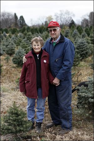 Peg and Wilbur Matthes at their evergreen tree farm in Ida, Mich.