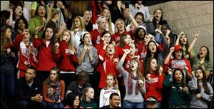 Fans in their Fighting Irish red cheer the Central Catholic championship football team. The group was among the more than 1,200 who gathered at the school Saturday.