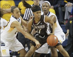 UT's Inma Zanoguera, left, and teammate Yolanda Richardson try to steal the ball from St. Bonaventure's Hannah Little in the second half.  The Rockets beat the Bonnies 59-45 to win the inaugural  Glass City Tournament in Toledo.