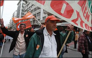 Municipal employees protest during a work stoppage by public sector union Friday in Athens. Several hundred people took part in the peaceful demonstration. Greek municipal workers have occupied hundreds of town halls across the country to protest against government plans to suspend 2,000 civil servants due to state budget cuts.