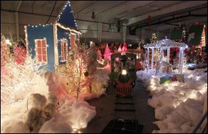 Youngsters ride the train through a Christmas display at Children's Wonderland at Tam-O-Shanter. The traditional event, which opened Saturday, is in its third year at the Sylvania site.