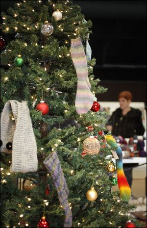 Knitted items on the shop's Christmas tree will be donated to the Ronald McDonald House.