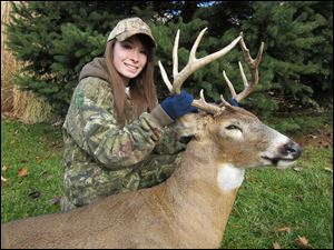 Katelyn Spalding, 17, a junior at Anthony Wayne High School, shows off the 10-point buck she took last month.