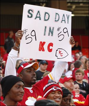 A Kansas City Chiefs fan holds a sign during the first half of an NFL football game against the Carolina Panthers at Arrowhead Stadium in Kansas City, Mo., Sunday.