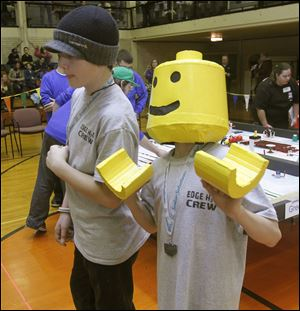 Edgewater Elementary students Layne Murphy and Kevin Reynolds watch their robot perform.