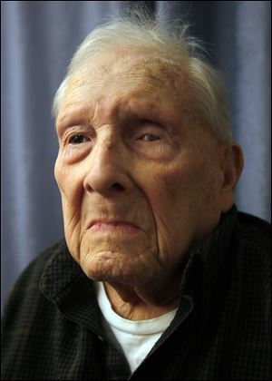 Paul Fisher, 99, poses for a portrait at Franciscan Care Center in Toledo. He celebrated his 100th birthday on Saturday.