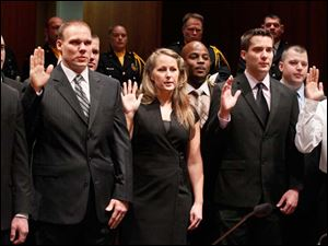 The swearing-in ceremony was held at One Government Center Monday.