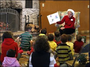 Mary Leugers reads a Christmas story to children during a Holiday Family Celebration, 'Evergreens Come Alive' at Nederhouser Community Hall in  Olander Park.