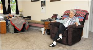 "LouVee Walker, 75, of Sweet Home, Ore., sits at home with her husband, Jim, who has Lewy body dementia. The Walkers live next to the home where Jim was born. He can do little for himself now. LouVee washes, dresses and feeds him.""I never think about not doing it,"" LouVee said."