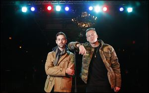 Ben Haggerty, better known by his stage name Macklemore, right, and his producer Ryan Lewis pose for a portrait at Irving Plaza in New York.