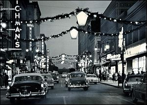 A bright downtown Toledo was a festive place for holiday shoppers in past years.