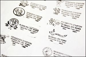 Past cancellation stamps at the Rudolph Post Office. More than 80,000 pieces of mail are expected to be cancelled from Dec. 1-24 in Rudolph, Ohio.