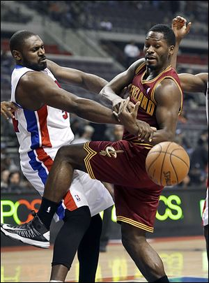 Detroit's Jason Maxiell, left, and Cleveland's Jeremy Pargo fight for the ball. The Pistons improved to 6-13. The Cavs fell to 4-14.