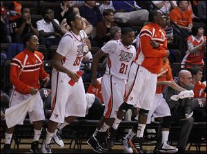 From left: BGSU's Damarkeo Lyshe, Cameron Black, Chauncey Orr and Craig Sealey celebrate off the bench as the team surges ahead during 2nd half.