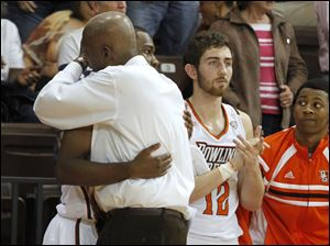 BGSU head coach Louis Orr hugs Craig Sealey at the end of the game against Wright State.