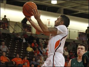 BGSU's Jordon Crawford drives to the basket in front of  Wright's A.J. Pacher.