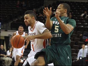 BGSU's Jordon Crawford is followed by Wright's Miles Dixon.