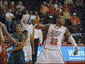 BGSU's Richaun Holmes celebrates getting fouled after scoring under the basket.