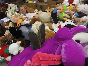 Walleye hockey players Max Campbell, left, and Joey Martin relax in the teddy bears they delivered