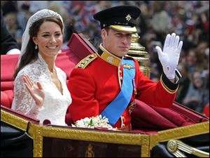 Britain's Prince William and his bride Kate, Duchess of Cambridge, leave Westminster Abbey, London, following their wedding. Palace officials announced Monday the Duke and Duchess of Cambridge are expecting a baby.