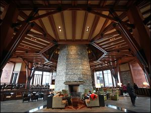 Cozy seating areas surround the stone fireplace column at the Ritz-Carlton Lake Tahoe.