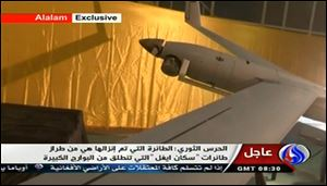 In this image taken from the Iranian state TV's Arabic-language channel Al-Alam, showed what they purport to be an intact, caputured ScanEagle drone aircraft put on display, as an exclusive broadcast.