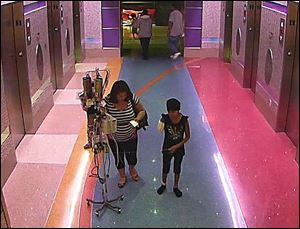 In this hospital surveillance photo released by the Phoenix Police Department, a woman is seen with her 11-year-old daughter, a leukemia patient who had her arm amputated and a heart catheter inserted due to an infection.