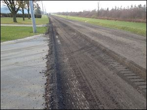 Crews used a soil stabilization method where the old road is pulverized on site, concrete is poured over the bed, and the materials are mixed with 16 inches of the soil.