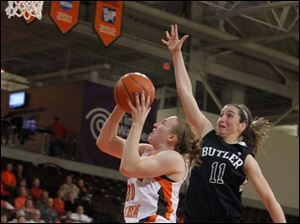 BGSU's Allison Papenfuss shoots as Butler's Hannah Douglas flies in for the block attempt.