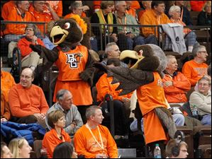 Frieda and Freddie Falcon interact with fans during the game.