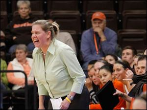 BGSU head coach Jennifer Roos yells out instructions to her team.