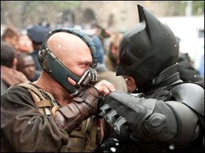 Tom Hardy as Bane and Chritian Bale as Batman in The Dark Knight Rises.