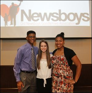 Student scholarship awardees, Brandon Jackson, left, Chantal White, center, Talia Ulrich, right, during  the Old News Boys Goodfellow Association annual dinner.