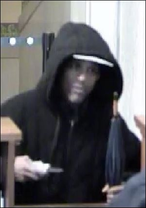 This surveillance photo from the Huntington bank at Madison and Huron streets shows the suspect in Tuesday's robbery.