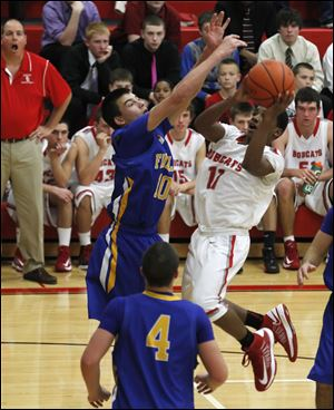 Findlay's Grant Niswander tries to block shot of Bowling Green's LaMonta' Stone.