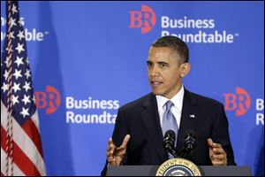 President Obama gestures as he speaks about the fiscal cliff at the Business Roundtable, an association of chief executive officers, in Washington, today.