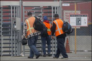Port workers return to work at the Port of Long Beach today.