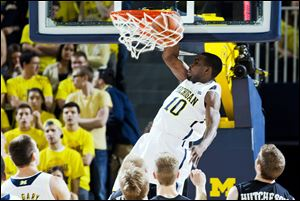 Michigan guard Tim Hardaway, Jr., dunks the ball in the first half of an  against Western Michigan on Tuesday at Crisler Center in Ann Arbor.