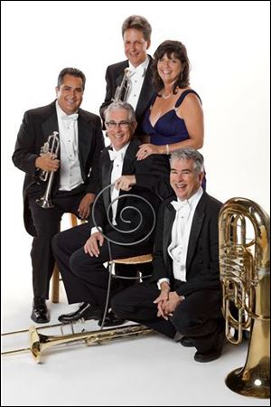 The Tower Brass Quintet. Clockwise from left:: Charles Saenz, Brian Bushong, Bernice Schwartz, David Saygers, and Dan Saygers