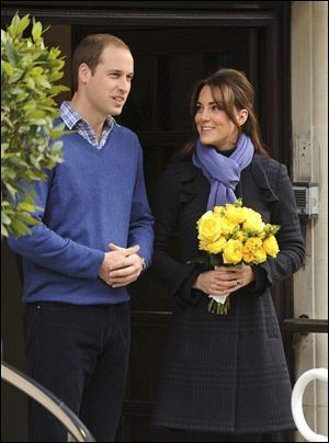 Britain's Prince William stands next to his wife Kate, Duchess of Cambridge as she leaves the King Edward VII hospital in central London on Thursday.