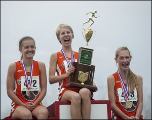 Two trips, two big trophies for the Liberty Center girls cross country team, which gave the school back-to-back state championships.