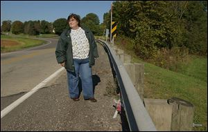 Leandre Tankersley recalls a fatal crash in 2002 at this spot on State Rt. 37, where a young mother's car flipped over the guardrail. Ms. Tankersley held the woman's hand as she died.