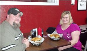 Butch and Angi Lapoint enjoy creative patties at PerrysBurgers in historic downtown Perrysburg.