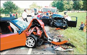 This head-on crash near Granville in central Ohio killed two occupants of the red Chevrolet Camaro, foreground, and injured the driver of the black Volkswagen Beetle in 2001. The crash happened on State Rt. 37, which has the highest fatality rate of any major Ohio route.