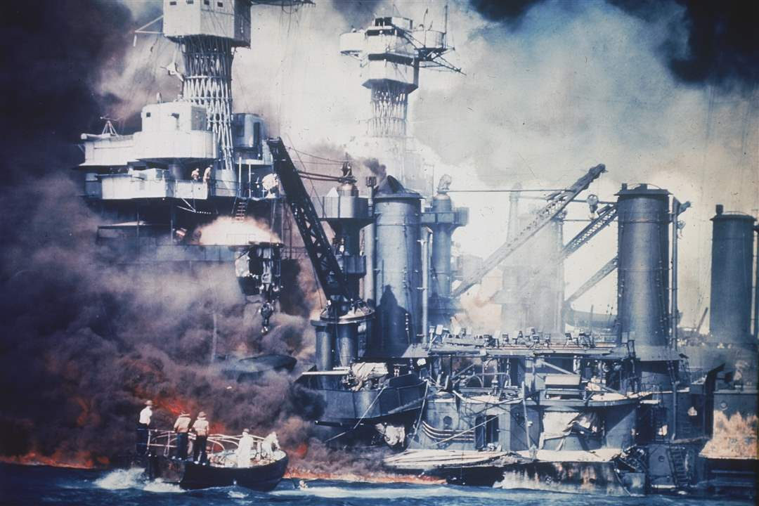 A-small-boat-rescues-a-USS-West-Virginia