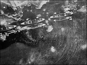 A Japanese Navy aerial view of smoking U.S. ships during the attack on Pearl Harbor, Hawaii.