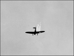 A Japanese plane goes into its last dive as it heads toward the ground in flames after it was hit by Naval anti-aircraft fire during a surprise attack on Pearl Harbor, Hawaii.