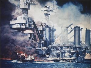 A small boat rescues a USS West Virginia crew member from the water after the Japanese bombing of Pearl Harbor, Hawaii on Dec. 7, 1941 during World War II. Two men can be seen on the superstructure, upper center. The mast of the USS Tennessee is beyond the burning West Virginia. On Dec. 7, 1941, Japanese Imperial Navy navigator Takeshi Maeda guided his Kate bomber to Pearl Harbor and fired a torpedo that helped sink the USS West Virginia. President Barack Obama on Thursday Dec. 6, 2012 issued a proclamation declaring Dec. 7 a day of remembrance in honor of the 2,400 Americans who died at Pearl Harbor. He urged federal agencies, organizations and others to fly their flags at half-staff.