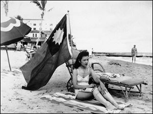 Ruth Lee, a hostess at a Chinese restaurant, flies a Chinese flag so she isn't mistaken for Japanese when she sunbathes on her days off in Miami, in the wake of the attack on Pearl Harbor. Lee was born in the U.S.